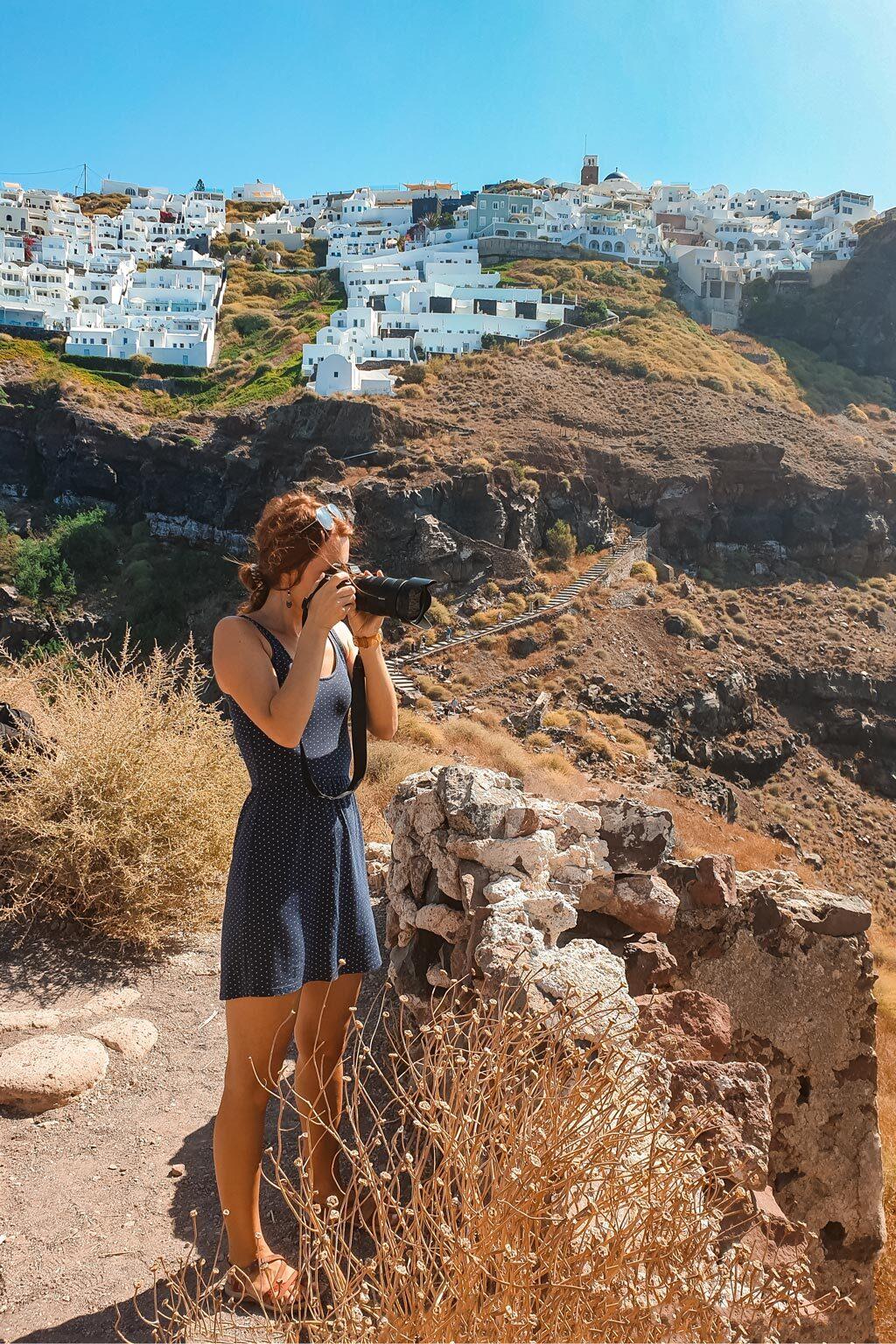 Julia Taking Photos in Best Photography Spots in Santorini