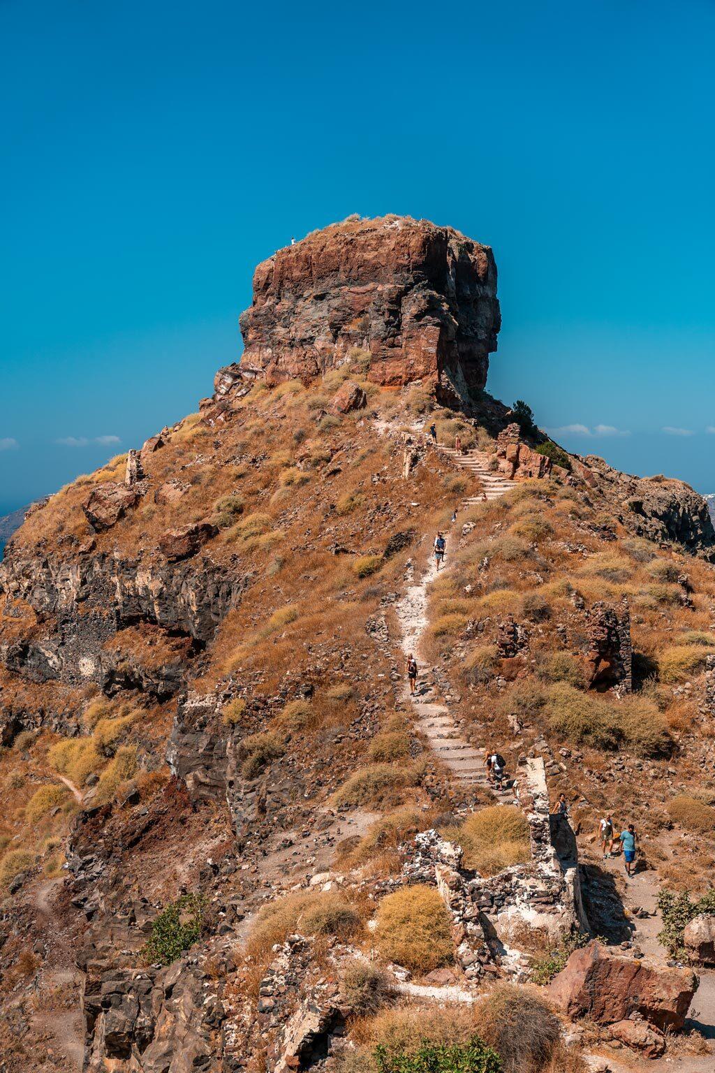 People Climbing to Skaros Rock in Santorini